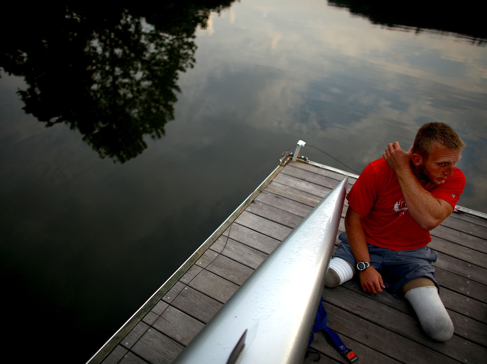 Jones sits on the dock at the Rivanna Reservoir before putting his boat in the water. The Paralympic movement began half a century ago when disabled vets from World War II started looking for a way to continue active lifestyles. (NPR)