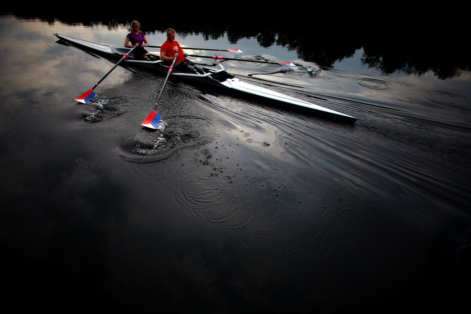 The teammates use a specially adapted rowing shell that is rigged with attachments so they can row comfortably, and slip in and out of the boat on their own. (NPR)