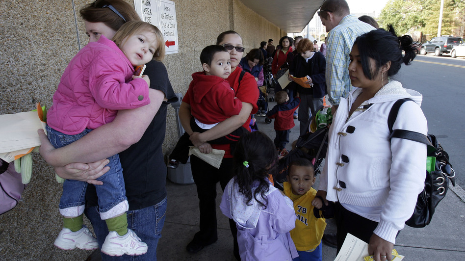 People wait in line at the Durham County Health Department for the H1N1 flu vaccination in Durham, N.C., in November 2009. (AP)