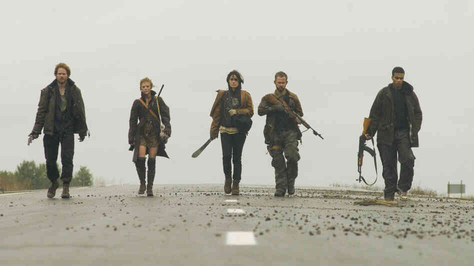 Trekking through a post-apocalyptic world in The Day, haggard survivors Adam (Shawn Ashmore), Mary (Ashley Bell), Shannon (Shannyn Sossamon), Rick (Dominic