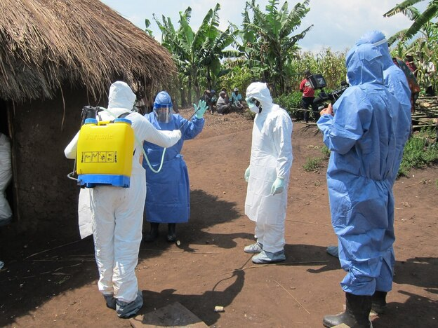 Disease detective Dr. Barbara Knust suits up to investigate an Ebola outbreak in Uganda last month. Knust chatted on Twitter last Wednesday about her career tracking down outbreaks for the Centers of Disease and Prevention. (CDC/Facebook)