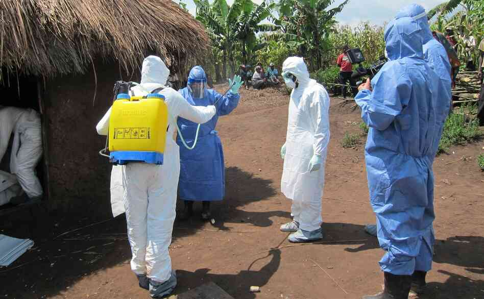 Disease detective Dr. Barbara Knust suits up to investigate an Ebola outbreak in Uganda last month. Knust chatted on Twitter last Wednesday about