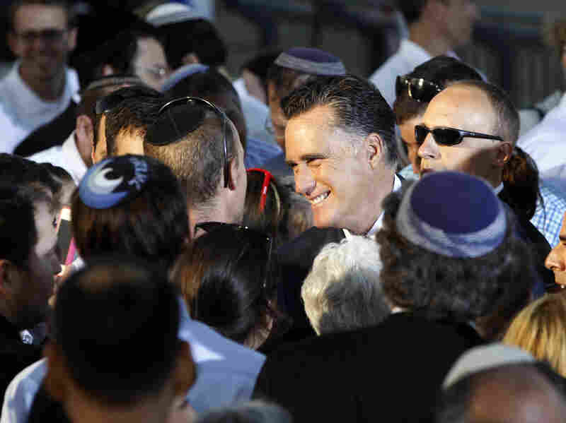 Republican Mitt Romney greets audience members after delivering a speech in Jerusalem on July 29. Israel's new prominence in campaign rhetoric has some in the Jewish state worried.