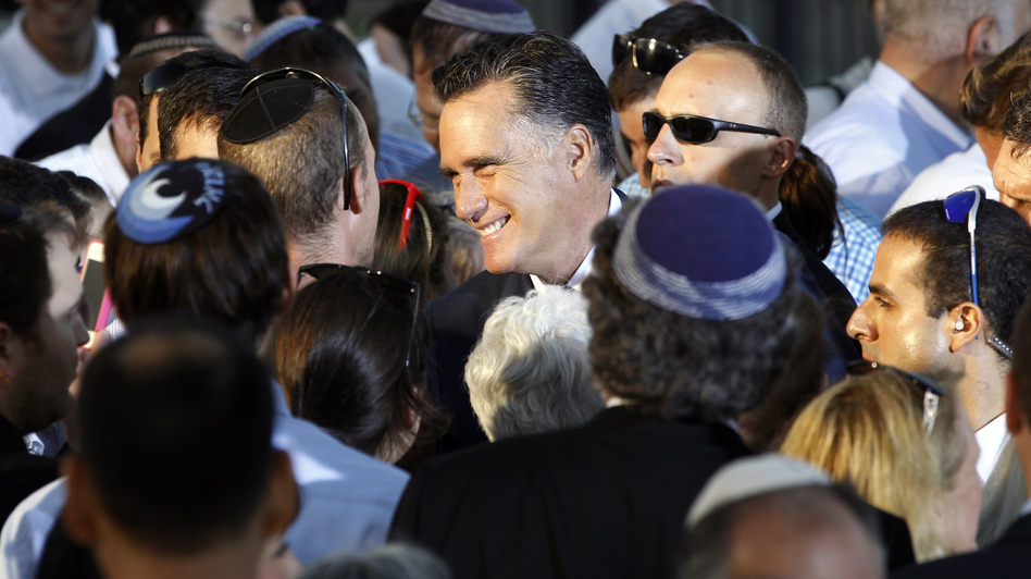 Republican Mitt Romney greets audience members after delivering a speech in Jerusalem on July 29. Israel's new prominence in campaign rhetoric has some in the Jewish state worried. (AP)