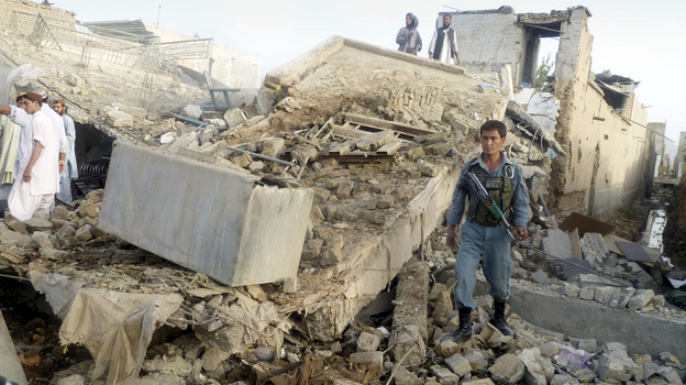The aftermath of a truck bomb in Kandahar, the main city in southern Afghanistan, which wounded the provincial police chief and killed two civilians Monday. Taliban attacks against Afghan officials are up sharply this year. (AP)