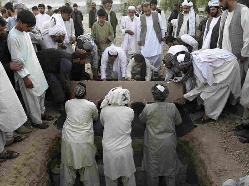Afghans bury the mayor of  Kandahar, Ghulam Haidar Hamidi, after he was killed in a suicide bombing in July 2011. Afghan officials have extensive security but are still vulnerable to attack.