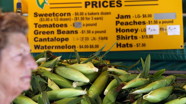 Grimes Sweetcorn worker Paulette Vandyke waits to sell fresh corn in Grimes, Iowa. The drought has pushed the price of corn per bushel up nearly 40 percent in the past two months. (Getty Images)