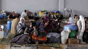 Syrians take refuge Thursday at