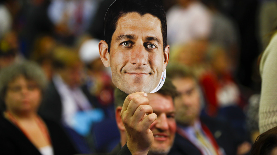 A delegate shows his support for Paul Ryan on a night dominated by the acceptance speech of the vice presidential nominee. (NPR)