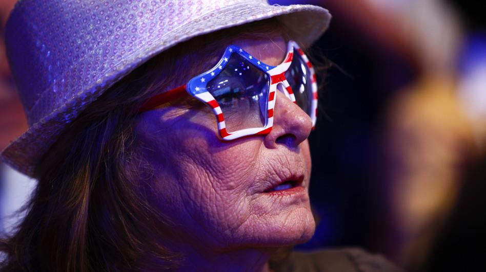 Carol Hurst of Merritt Island, Fla., listens to a speaker on Wednesday at the Republican National Convention. (NPR)