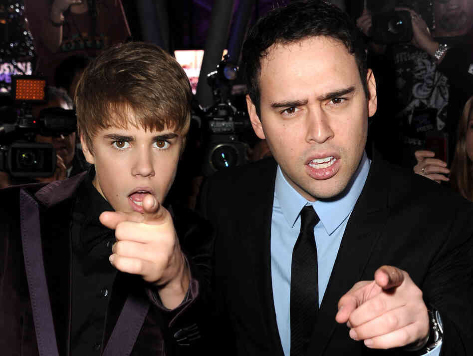Justin Bieber and manager Scooter Braun last year.