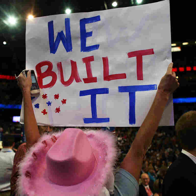 A woman holds a sign at the Republican National Convention Tuesday in Tampa, Fla.
