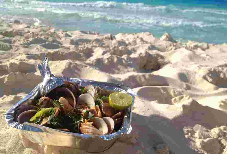 Gandoufly steamed clams are a favorite snack on Egypt's Mediterranean coast, where Egyptians flock on the weekends to escape Cairo's heat and humidity.