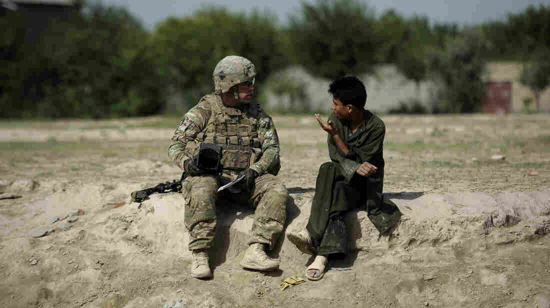 U.S. soldiers still patrol in Afghanistan, like this one speaking with a young man in the eastern province of Khost in August. However, Afghan forces are taking on increased responsibility as the U.S. draws down and prepares for its troops to leave by the end of 2014.
