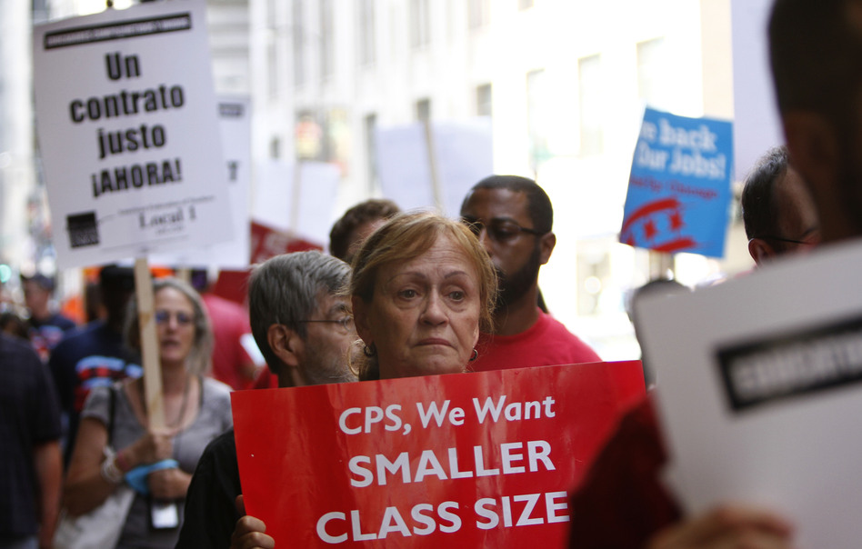 Chicago Teachers Union members picket on Aug. 22 in Chicago.
