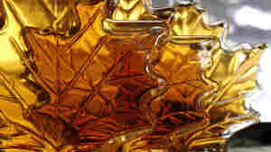 "Maple syrup bottles sit on a shelf. A Canadian syrup producers' federation says a warehouse holding ""over 10 million pounds of maple syrup"" was recently burglarized."