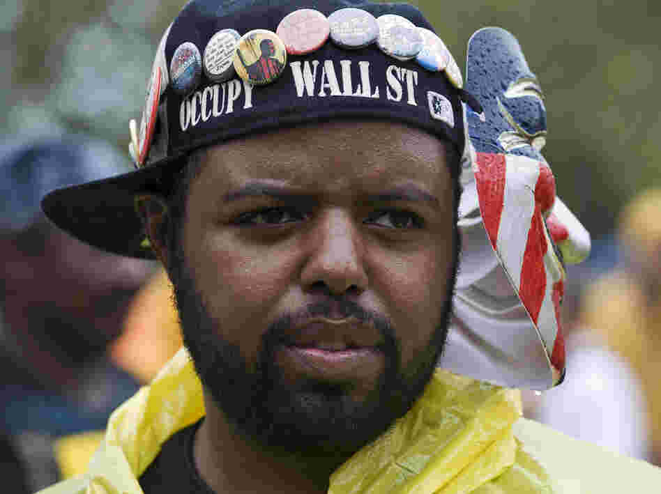 Occupy Wall Street activist Jason Woody listens to a speaker during a rally before the start of the Republican National Convention in Tampa, Fla., on Aug. 27.
