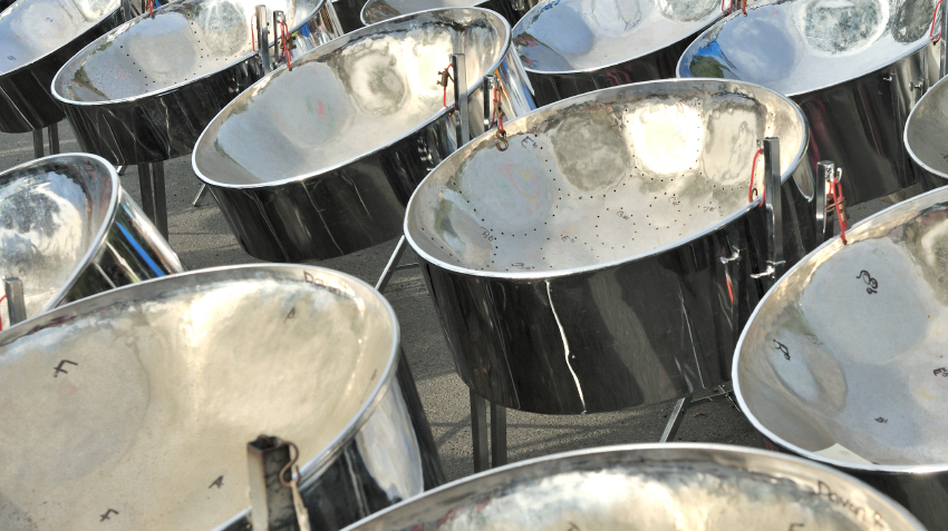 Every year at the Panorama Competition in Brooklyn, massive steel-pan orchestras perform virtuosic arrangements of calypso songs. (iStockPhoto)