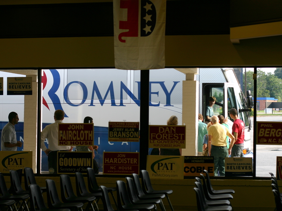 Romney supporters line up to tour the campaign bus. (NPR)