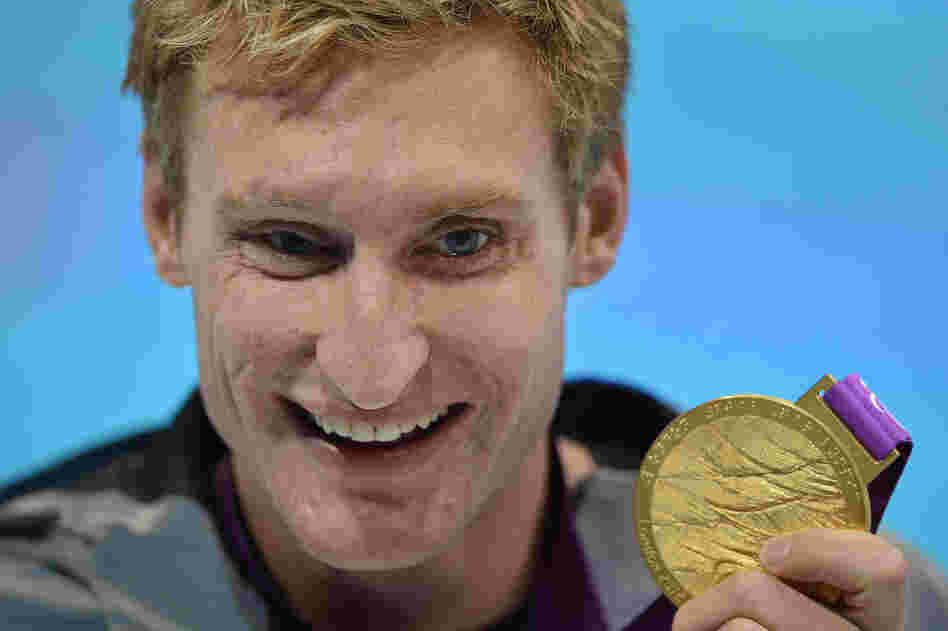 U.S. swimmer Bradley Snyder poses with his gold medal after winning the men's 100m freestyle - S11 final at the London 2012 Paralympic Games.
