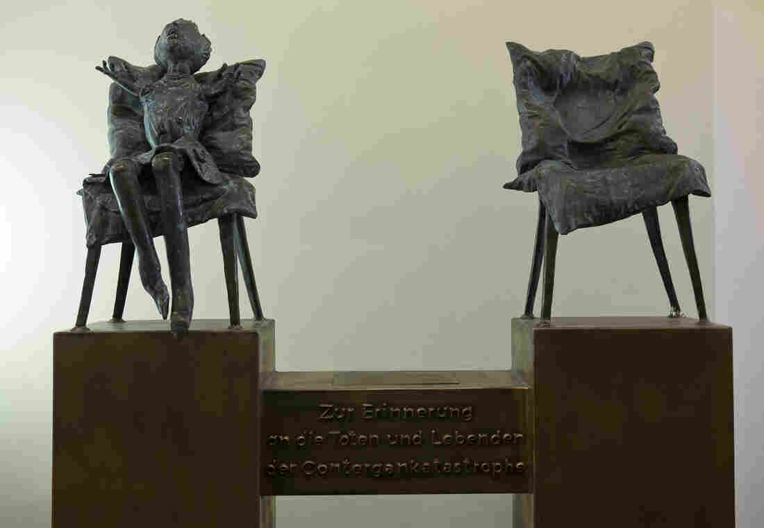 """A sculpture by the artist Bonifatius Stirnberg memorializes the victims of thalidomide, a drug that caused thousands of birth defects. A translation of the German text below the chairs: """"In memory of the dead and the survivors of the thalidomide catastrophe."""""""