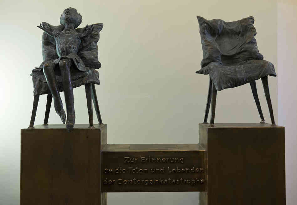 "A sculpture by the artist Bonifatius Stirnberg memorializes the victims of thalidomide, a drug that caused thousands of birth defects. A translation of the German text below the chairs: ""In memory of the dead and the survivors of the thalidomide catastrophe."""