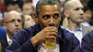 President Obama drinks a beer — that's presumably not from the White House — as he watches the U.S. men's basketball team play Brazil in an Olympic exhibition game in July.