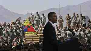 Members of the military listen to President Obama during his visit to Fort Bliss, Texas, on Friday.