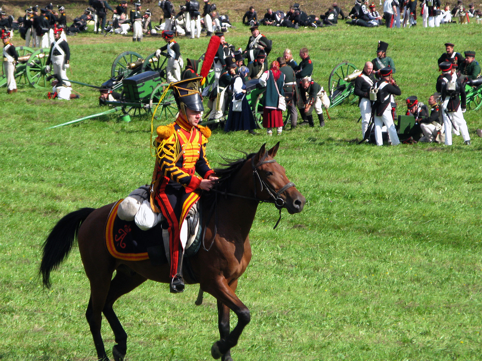 A Russian hussar races past the artillery as the battle is about to begin. (NPR)