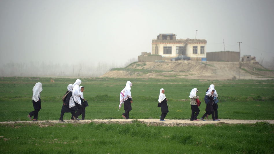 Afghan girls walk home from school in Kunduz province earlier this year. Despite progress in recent years, girls who want an education face threats from the Taliban and other extremists, and sometimes even their own families. (AFP/Getty Images)