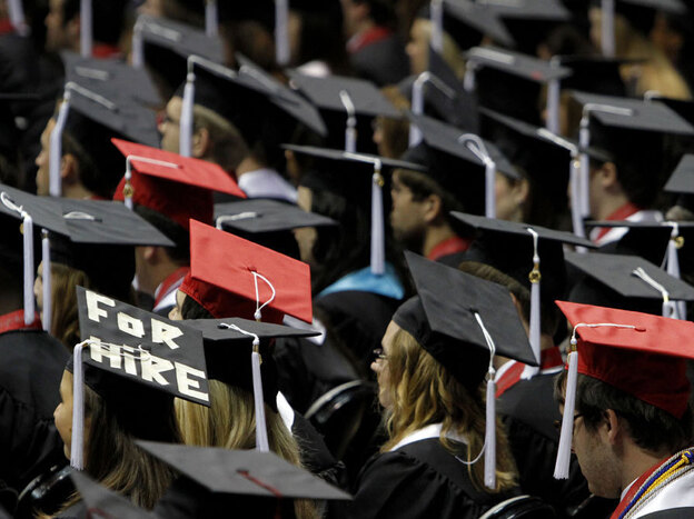 Graduates attend a ceremony at the University of Alabama in Tuscaloosa. Writer Joel Kotkin notes that many recent college grads are saddled with high debt and dim job prospects.