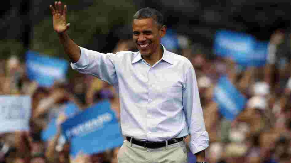President Obama waves as he walks on stage during a campaign stop on the campus of the University of Colorado in Boulder on Sunday.