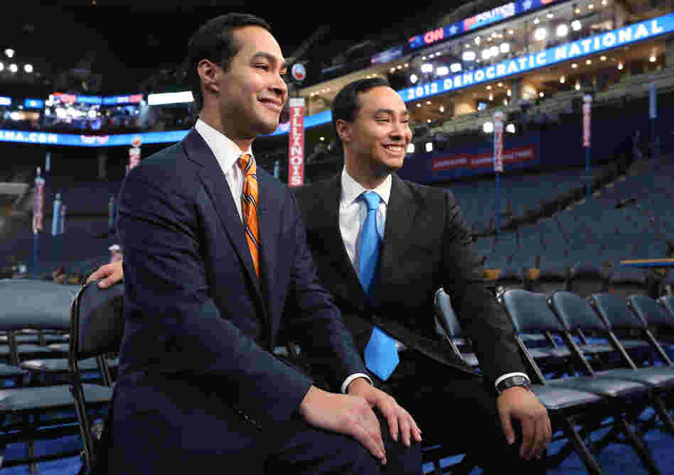 San Antonio Mayor Julian Castro, left, and his twin brother State Rep. Joaquin Castro give an interview during preparations for the Democratic National Convention at Time Warner Cable Arena on Monday.