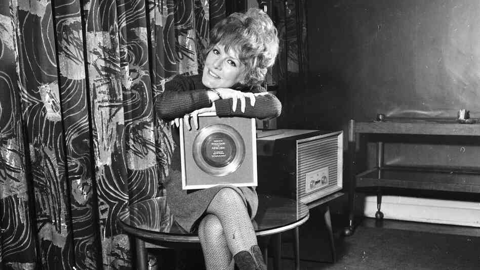 "A less complicated time? Petula Clark holds her 1965 gold record for ""Downtown,"" an uptempo song in a major key."