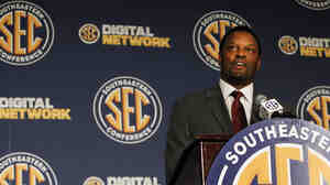 Texas A&M Coach Kevin Sumlin speaks to reporters at the Southeastern C