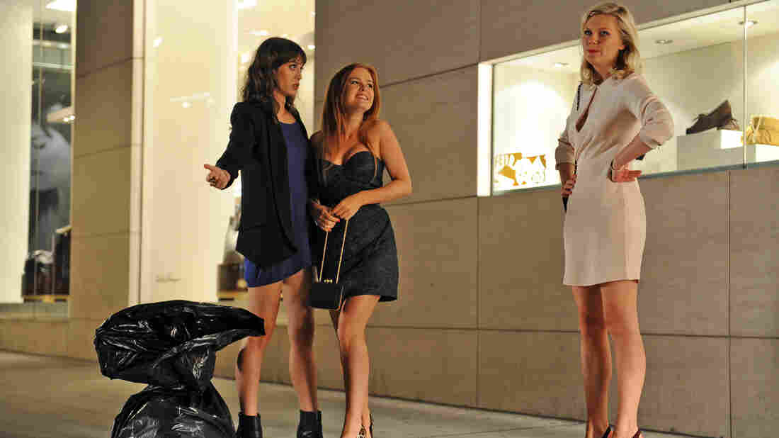 Party Animals: Lizzy Caplan (from left), Isla Fisher and Kirsten Dunst are the brazen bridesmaids who make trouble for bride-to-be Rebel Wilson in Bachelorette.