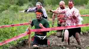 A runner tries to escape with his life as zombies pursue him during the Run for Your Lives race. The 5K course is littered with obstacles — and the undead.