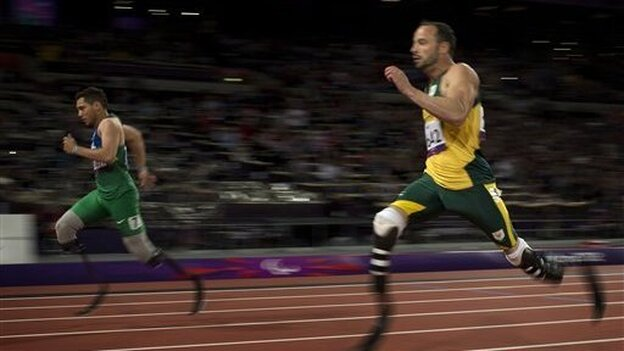 In a surprise finish, Brazil's Alan Fonteles Cardoso Oliveira (left) races past South Africa's Oscar Pistorius to win a gold medal in the 200-meter race at the 2012 London Paralympic Games.