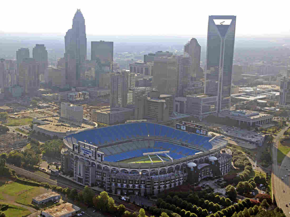 The skyline of Charlotte, N.C., rises behind Bank of America Stadium.