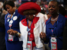 Attendees of the Democratic National Convention in Charlotte, N.C., pray during the invocation. Support for President Obama has remained high for some black voters at the DNC, but enthusiasm for him has waned.
