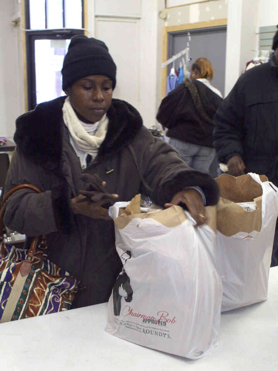 Jacque Holland, 43, of Milwaukee picks up food at the