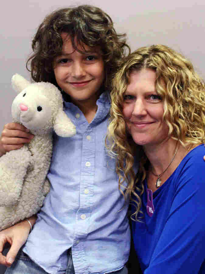 "Graham Haggett, 11, and his mother, Shelli Wright, remembered Graham's grandmother Sandra Lee Wright, who was killed in the World Trade Center attacks. Graham brought ""Lammy,"" a stuffed animal his grandmother gave him, to the interview."
