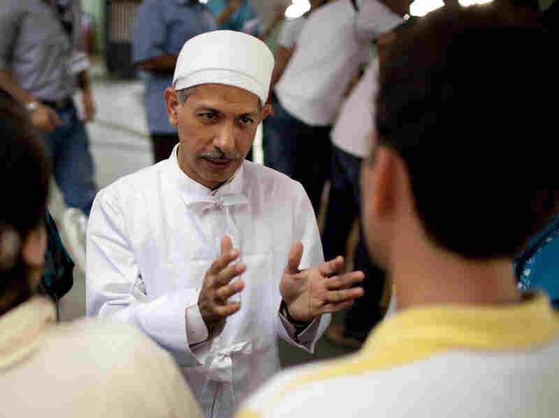 Zoroastrian priest Ramiyar Karanjia fields questions during a meeting with young members of the faith in Pune, India, on May 13, 2010.