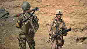 A U.S. Marine (right) and an Afghan National Army soldier on patrol this summer in Afghanistan's Helmand Province.
