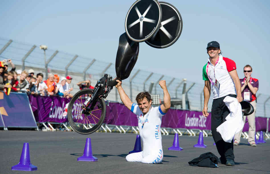 Alex Zanardi celebrates winning the gold medal in the men's individual H4 time trial cycling final at the London 2012 Paralympic Games at Brands Hatch circuit, in Kent, southern En