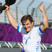 Alex Zanardi celebrates winning the gold medal in the men's individual H4 time trial cycling final at the London 2012 Paralympic Games at Brands Hatch circuit, in Kent, southern England. Zanardi's legs were amputated after a racecar crash in 2001.