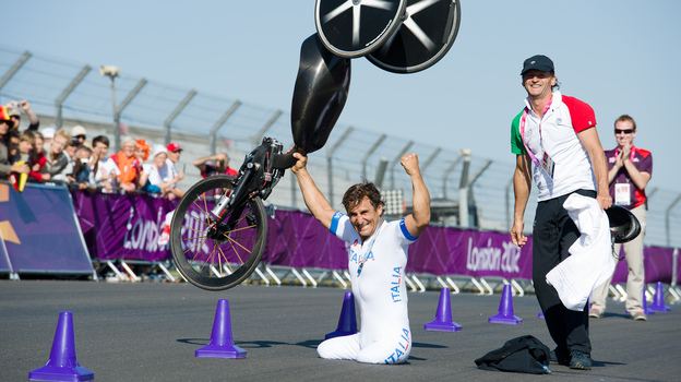 Alex Zanardi celebrates winning the gold medal in the men's individual H4 time trial cycling final at the London 2012 Paralympic Games at Brands Hatch circuit, in Kent, southern England. Zanardi's legs were amputated after a racecar crash in 2001. (AFP/Getty Images)