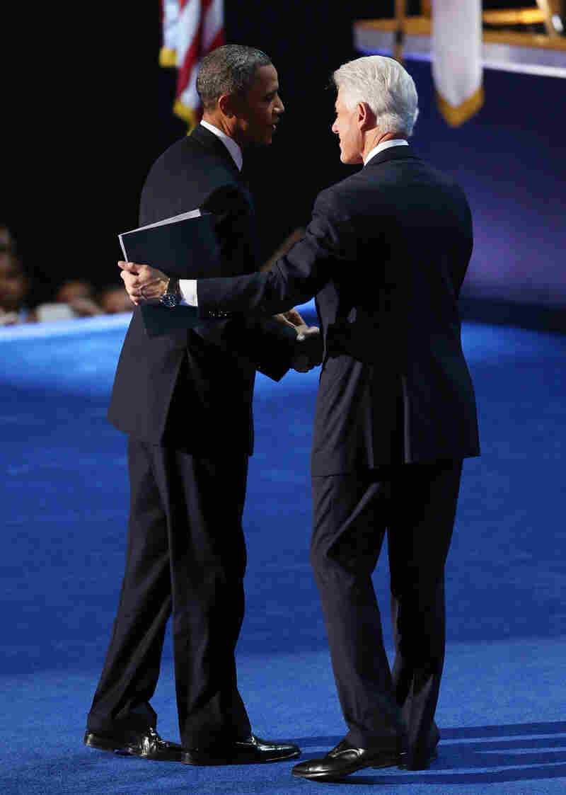 President Obama greets former President Bill Clinton onstage at the Democratic National Convention.