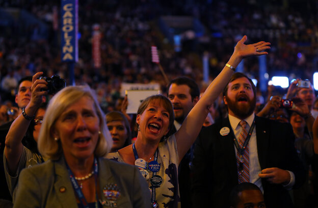 Attendees sing and dance as musician James Taylor performs onstage during the final day of the Democratic National Convention at Time Warner Cable Arena on Thursday.
