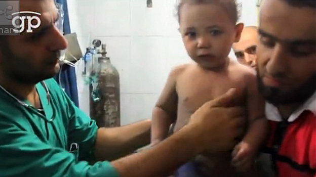 One-year-old Hassan was discovered in the rubble of an apartment building in Aleppo, Syria, giving his rescuers a moment of hope on a sad day. His parents were killed by the helicopter strike. (Global Post)